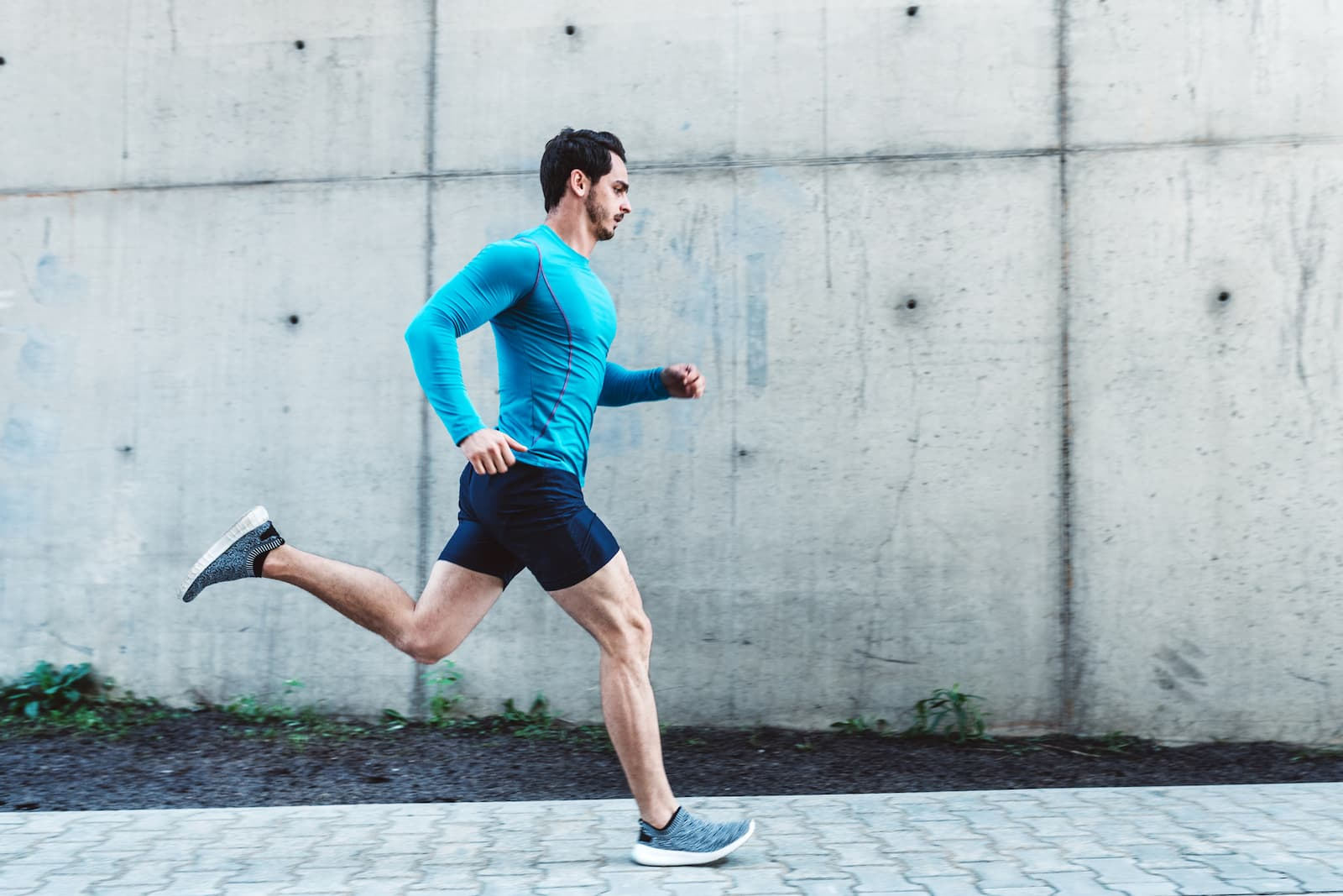 man running down the street in athletic clothes