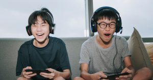 kids playing video games in their living room