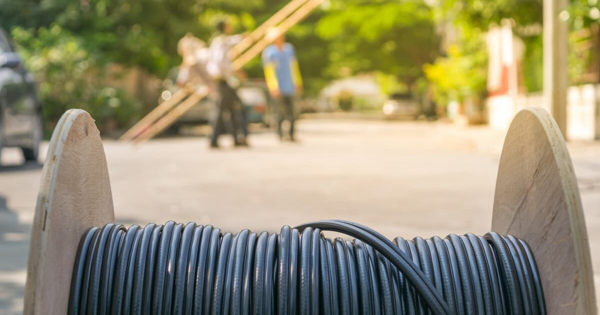 roll of fiber optic cable at construction site