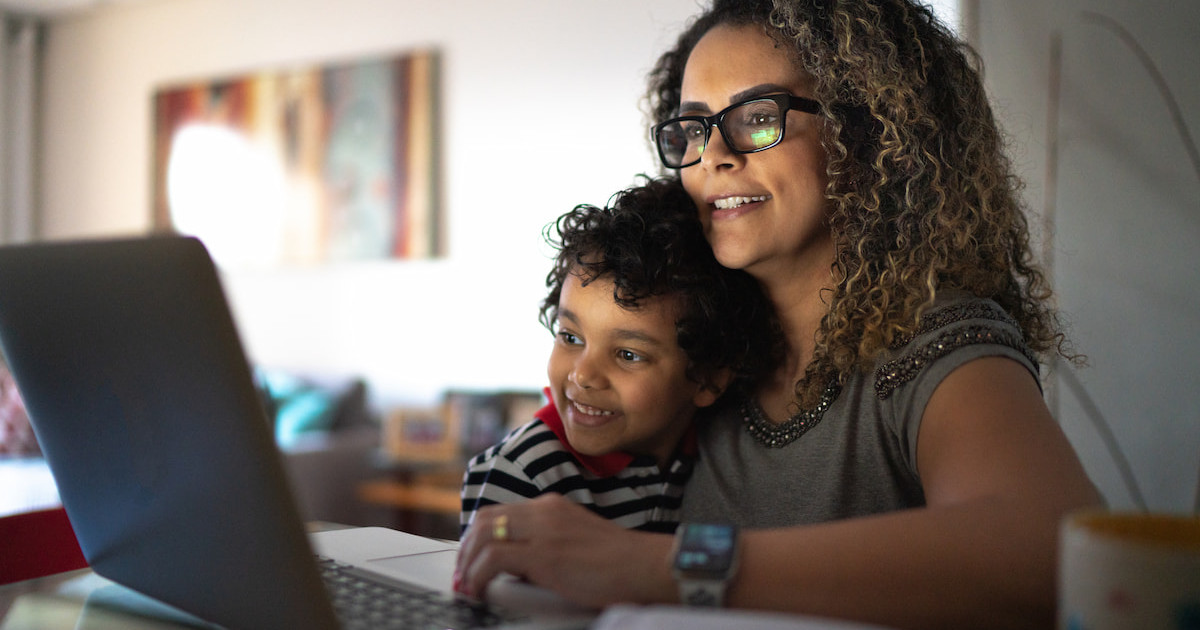 A woman and her child using a laptop