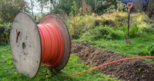 spool of fiber cable in a backyard