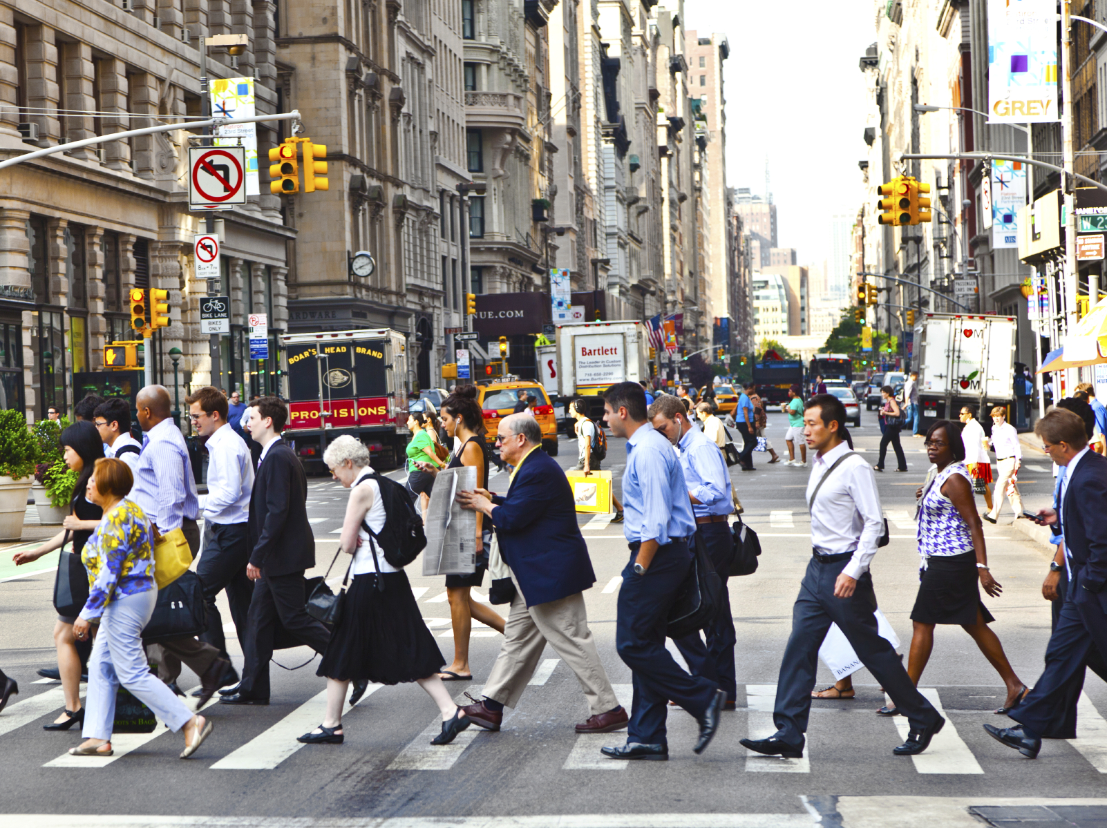 NEW YORK, USA – JULY 13: People hurry downtown Manhattan to th